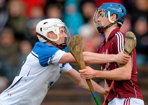 Waterford's Brian O'Halloran clashes with Johnny Coen of Galway during the game