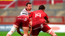 Ulster's Tommy Bowe feels the full force of a combined tackle from Munster's Dan Goggin (left) and Jean Kleyn. Photo by Diarmuid Greene/Sportsfile