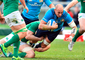 Italy's N°8 Sergio Parisse is tackled during the Six Nations International Rugby Union match between Italy and Ireland at the Olympic Stadium in Rome on February 7, 2015. AFP PHOTO / GABRIEL BOUYSGABRIEL BOUYS/AFP/Getty Images