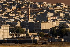 Houses in the Kurdish border town of Kobani (also called Ayn Al-Arab) are seen from the Turkish site in Suruc September 28, 2014 south of Sanliurfa, Turkey.(Photo by Carsten Koall/Getty Images)