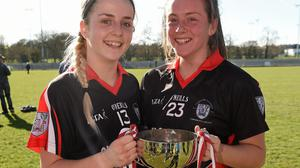TCD players Rebecca McDonnell, left, and Stacey Flood, both from Clan na Gael Fontenoy, Dublin, celebrate with the Giles Cup in 2015