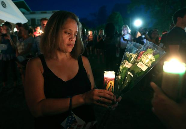 Charlottesville resident Mailynn Shurtleff lights a candle during a candlelight vigil on the campus of the University of Virginia (Andrew Shurtleff /The Daily Progress via AP)