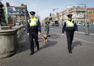Garda Caoileann Fitzmaurice and Garda Gareth McElhone on patrol on a very quiet O'Connell Bridge in Dublin. Photo: Frank McGrath