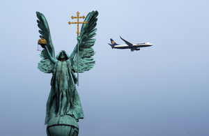 2010: A Ryanair airplane flies behind a statue of the Archangel Gabriel in Budapest's Heroes' square. Photo: ATTILA KISBENEDEK/AFP/GettyImages