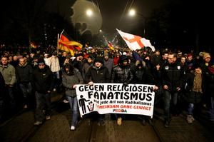 "Participants take part in a demonstration called by anti-immigration group PEGIDA, a German abbreviation for ""Patriotic Europeans against the Islamization of the West"", in Dresden January 5, 2015. REUTERS/Fabrizio Bensch"