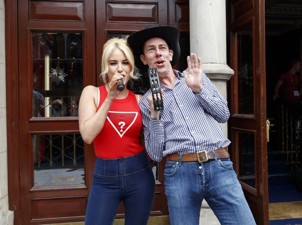 01/05/2019 Ryan Tubridy pictured performing with country star Cliona Hagan outside the Gaiety Theatre ahead of the RTÉ Late Late country Special this Friday. Picture Andres Poveda