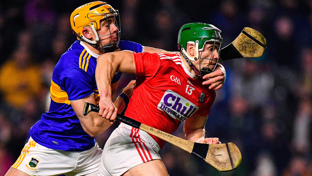 Alan Cadogan of Cork is tackled by Seán O'Brien of Tipperary. Photo by Eóin Noonan/Sportsfile