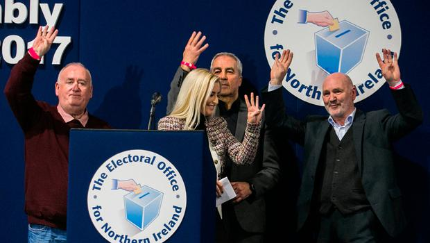 Sinn Fein candidates in Belfast West MLA's celebrate with Fra McCann, Orlaith Flynn, Pat Sheehan, and Alex Maskey holding up four fingers during their declaration speech at the Titanic Exhibition Centre, Belfast. Liam McBurney/PA Wire
