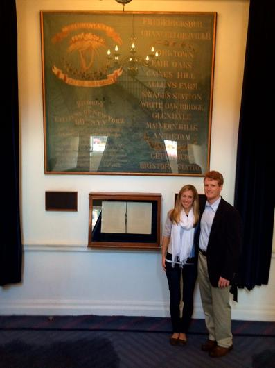 Congressman Joe Kennedy and his wife in front of the 69th Regiment's banner