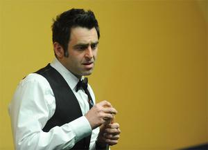 Ronnie O'Sullivan at the table in his second round match against Ali Carter