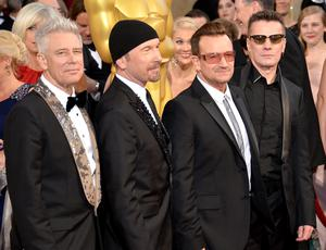 (L-R) Musicians Adam Clayton, The Edge, Bono, and Larry Mullen Jr. of U2 attend the Oscars held at Hollywood & Highland Center on March 2, 2014 in Hollywood, California.  (Photo by Michael Buckner/Getty Images)