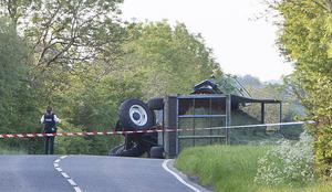 Police at the scene of an accident involving a tractor on the Pharis Road near Armoy. Pic Steven McAuley/McAuley Multimedia
