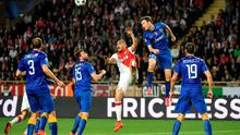 Juventus defender Stephan Lichtsteiner and Monaco's Layvin Kurzawa go for a  header during the quarter final second leg