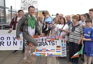 Tony Mangan, 57, from the Liberties in Dublin is greeted by family, friends and supporters at Dublin Port after an epic four year 50,000km run around around the world which he plans to end after a running circuit of Ireland and the Dublin Marathon. Dublin, Ireland. Artur Widak/PA Wire