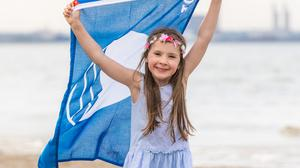 Awards: Alannah Culhane marking the Blue Flag recipients last year at Seapoint, Co Dublin, but Courtown's joy was short-lived this year. Photo: Naoise Culhane