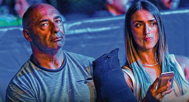 Pete Taylor, who was injured in the shooting, and his partner Karen Brown at a boxing event in Belfast in 2018