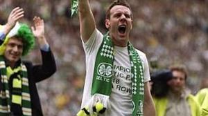 9 May 1998: Craig Burley of Celtic holds the trophy aloft after Celtic beat St Johnstone 2-0 to become the league champions. \ Mandatory Credit: Shaun Botterill/Allsport