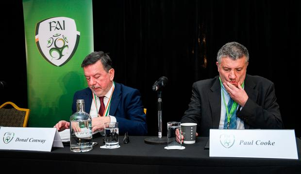 FAI President Donal Conway, left, and FAI lead executive Paul Cooke during the FAI Annual General Meeting at the Citywest Hotel in Dublin. Photo by Ramsey Cardy/Sportsfile