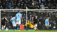 Sergio Aguero of Manchester City scores his team's fifth goal from the penalty spot during the FA Cup Fourth Round match between Manchester City and Burnley at Etihad Stadium on January 26, 2019 (Photo by Alex Livesey/Getty Images)