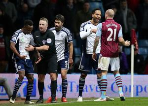 """Football - Aston Villa v West Bromwich Albion - Barclays Premier League - Villa Park - 3/3/15 West Brom's Saido Berahino is held back by referee Jonathan Moss after clashing with Aston Villa's Alan Hutton Action Images via Reuters / Alex Morton Livepic EDITORIAL USE ONLY. No use with unauthorized audio, video, data, fixture lists, club/league logos or """"live"""" services. Online in-match use limited to 45 images, no video emulation. No use in betting, games or single club/league/player publications.  Please contact your account representative for further details."""