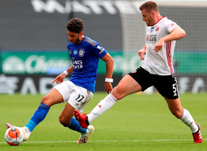 Sheffield United's Jack O'Connell keeps the ball ahead of Leicester City's Ayoze Perez. Photo: PA