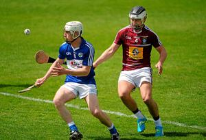 Laois' Zane Keenan in action against Gary Greville of Westmeath