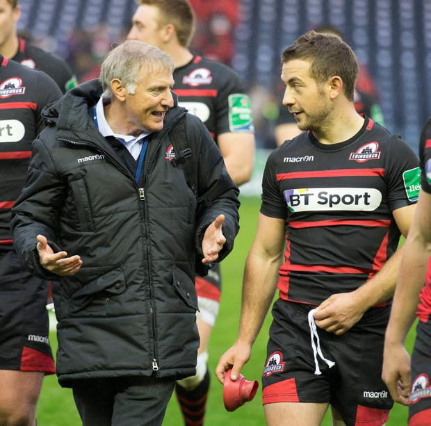 Edinburgh coach Alan Solomon with man of the match Greig Laidlaw at the end of the Heineken Cup match at Murrayfield