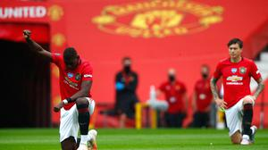 Manchester United's Paul Pogba take a knee in support of the Black Lives Matter movement. Photo: Clive Brunskill/NMC Pool/PA Wire