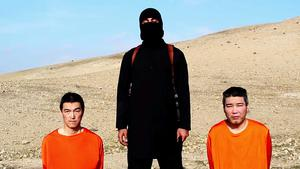 This image taken from an online video released by the Islamic State group's al-Furqan media arm on Tuesday, January 20, purports to show the group threatening to kill two Japanese hostages that the militants identify as Kenji Goto Jogo, left, and Haruna Yukawa, right, unless a $200 million ransom is paid within 72 hours (AP Photo)