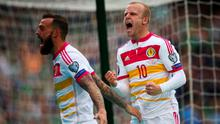 Steven Naismith (R) and Steven Fletcher of Scotland celebrate the goal scored by Shaun Maloney during the UEFA EURO 2016 Qualifier Group D match between Republic of Ireland and Scotland at Aviva Stadium