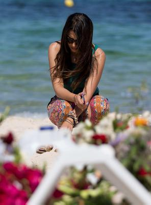 A tourist mourns at a makeshift memorial to the victims of the beach massacre in Tunisia. Photo: Getty