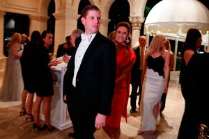 Eric Trump, left, and his wife Lara Yunaska arrive for a New Year's Eve party at Mar-a-Lago, Palm Beach, Florida. Image: AP Photo/Evan Vucci