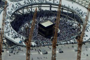 FILE - In this Wednesday, Oct. 16, 2013 file photo, cranes rise at the site of an expansion to the Grand Mosque as Muslim pilgrims circle counterclockwise around the Kaaba at the Grand Mosque in Mecca, Saudi Arabia. A towering construction crane toppled over on Friday, Sept. 11, 2015 during a violent rainstorm in the Saudi city of Mecca, Islam?s holiest site, crashing into the Grand Mosque and killing dozens of people ahead of the start of the annual hajj pilgrimage later this month.(AP Photo/Amr Nabil, File)