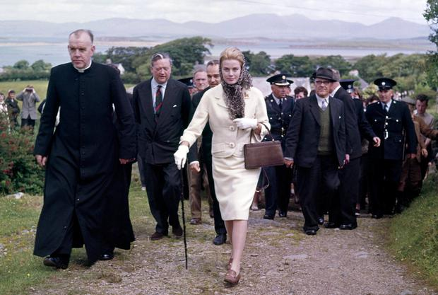 Grace us with your presence: Princess Grace of Monaco with a priest and entourage climbing a hill to the Shrine of Our Lady at Croagh Patrick, Co Mayo, in 1961. (Photo by Ray Bellisario/Popperfoto/Getty Images)