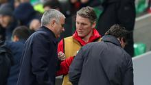 Bastian Schweinsteiger speaks with Jose Mourinho