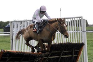 Annie Power and Ruby Walsh at the final hurdle on their way to victory in the OLBG Mares Hurdle at Doncaster Racecourse