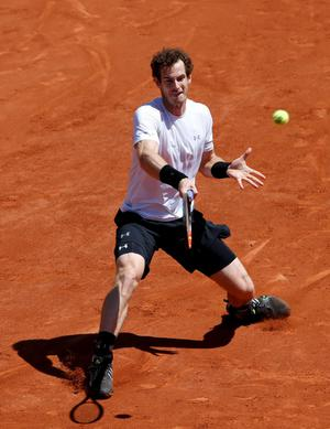 Andy Murray of Britain returns the ball to Novak Djokovic of Serbia during their men's semi-final match at the French Open tennis tournament at the Roland Garros stadium in Paris, France, June 6, 2015.               REUTERS/Jean-Paul Pelissier