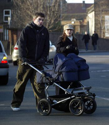 TV Presenter Mark Durden-Smith and his wife Rachel walk their new twin babies in their double Bugaboo.