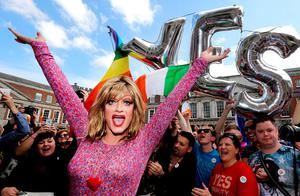 Panti Bliss celebrates with marriage equality supporters at Dublin Castle. Photo: Gerry Mooney