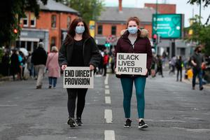 People arrive at a Black Lives Matter protest rally outside the US Embassy in Dublin Photo credit: Brian Lawless/PA Wire