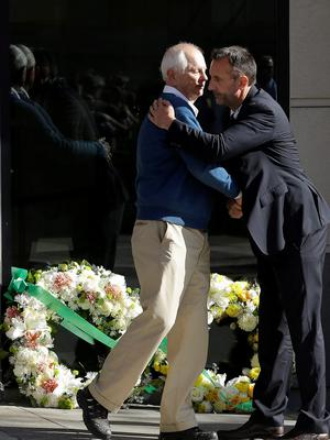Berkeley Mayor Tom Bates, left, hugs Philip Grant, Consul General of Ireland of the Western United States, after placing wreaths at the Library Gardens apartment complex in Berkeley, Calif., Tuesday, June 16, 2015. (AP Photo/Jeff Chiu)