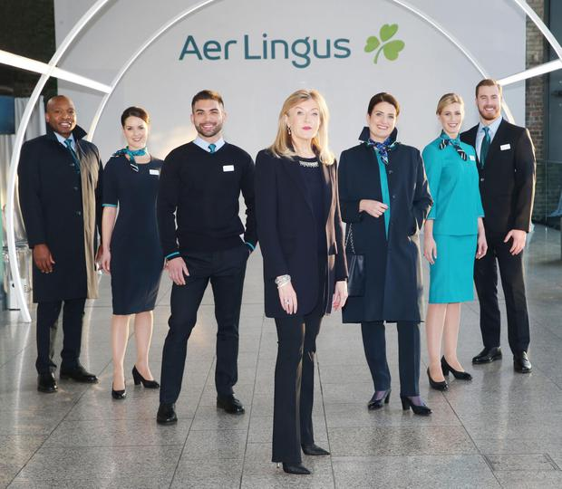 Designer Louise Kennedy with Aer Lingus cabin crew and staff modelling the new uniform