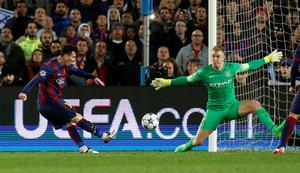 Manchester City's Joe Hart saves from Barcelona's Lionel Messi
