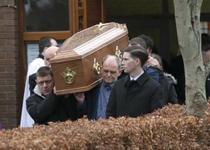 The remains of Patricia Quinn pictured leaving her funeral mass