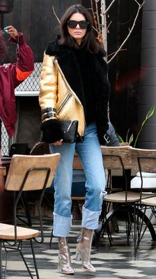 Kendall Jenner went for lunch with friends in West Hollywood wearing a gold Acne aviator jacket. Picture:  JLM / Splash News