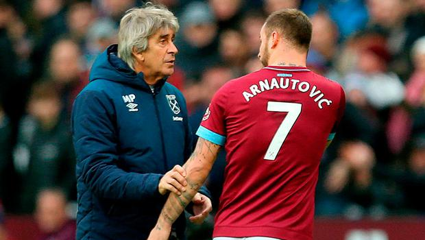 West Ham United's Marko Arnautovic speaks with manager Manuel Pellegrini as he leaves the pitch. Photo: Steven Paston/PA Wire