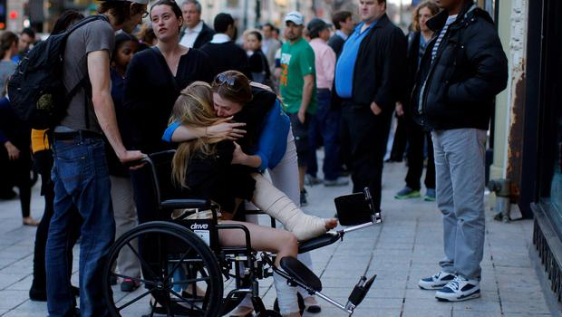 A Boston Marathon bombing survivor receives a hug next to the site of the first bomb explosion on Boylston Street in Boston, Massachusetts in this April 24, 2013 file photo. Tuesday marks the one-year anniversary of theBostonMarathonbombing on April 15, 2013, when two Chechen brothers allegedly planted pressure-cooker bombs near the race's finish line, killing three people and wounded more than 260.  REUTERS/Brian Snyder