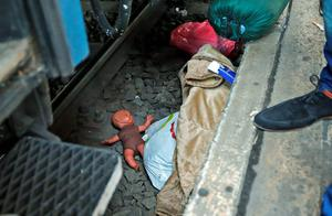 A toy doll is left behind and lays on the tracks at the railway station in Budapest, Hungary, Thursday, Sept. 3, 2015. Over 150,000 migrants have reached Hungary this year, most coming through the southern border with Serbia, and many apply for asylum but quickly try to leave for richer EU countries.(AP Photo/Frank Augstein)