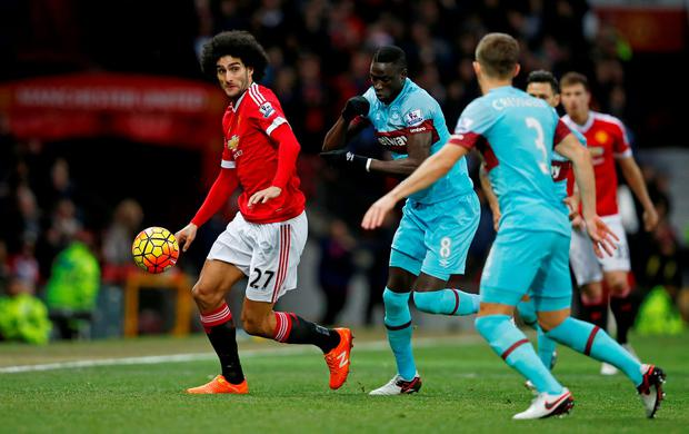 """Football Soccer - Manchester United v West Ham United - Barclays Premier League - Old Trafford - 5/12/15 Manchester United's Marouane Fellaini in action with West Ham's Cheikhou Kouyate Reuters / Andrew Yates Livepic EDITORIAL USE ONLY. No use with unauthorized audio, video, data, fixture lists, club/league logos or """"live"""" services. Online in-match use limited to 45 images, no video emulation. No use in betting, games or single club/league/player publications.  Please contact your account representative for further details."""
