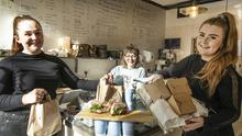 Doing their bit: Laine, My Love coffee shop staff Caitlin Chillingworth, Sophie O'Reilly and Aine McDougall with unsold sandwiches they donated to the homeless. Photo: David Conachy